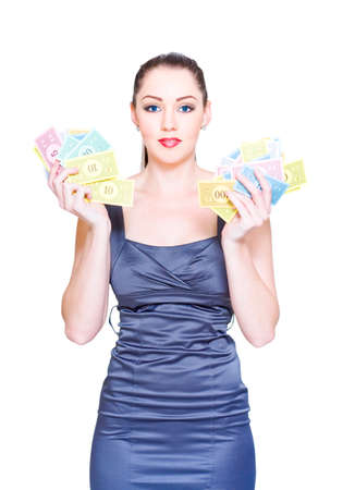 speculate: Isolated Studio Portrait Of A Baffled, Bemused And Perplexed Woman Holding A Handful Of Cash Savings In A Price Reduction, Money Markdowns And Discount Concept