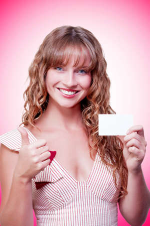 credentials: Business woman handing over a blank business card with thumbs up in a depiction of a good business deal