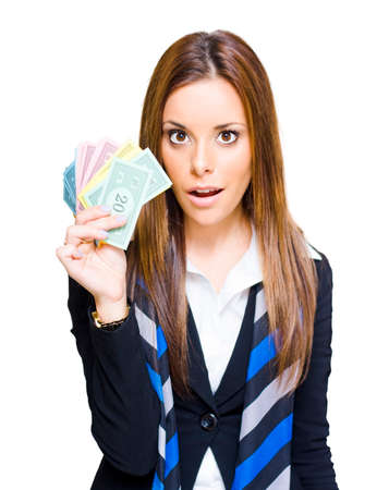 monopoly money: Business Win And Success Concept Sees A Surprised Attractive Young Business Woman Holding A Handful Of Money Bills Or Notes With An Excited Expression