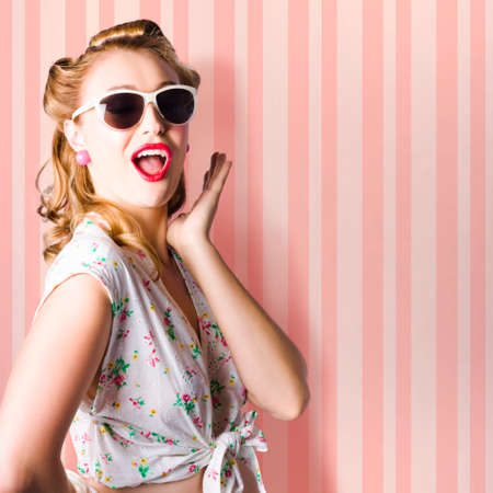 fashion sunglasses: Surprised Young Woman With Pinup Hair Style And Makeup Posing In Striped Copy Space Retro Studio Stock Photo