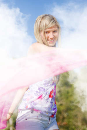 frolicking: A Happy Woman Plays Around With A Pink Scarf While Smiling In A Foggy Field Frolic