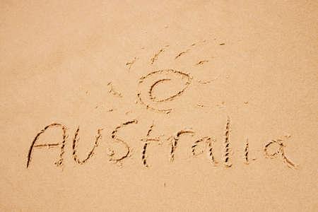 spells: Sun Surf Sand, Spells Out Australia On A Beach Shoreline
