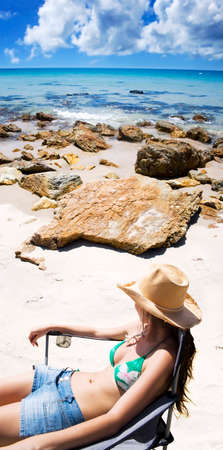 holidaying: Beach Woman Relaxing By A Beautiful Rocky Island Coastline