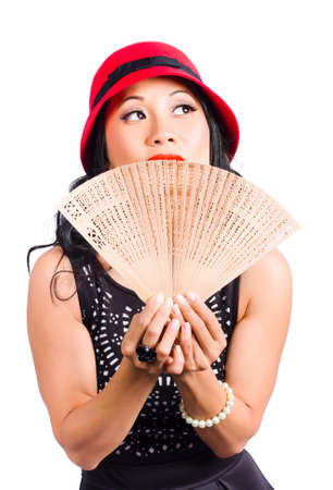 looking in corner: Stylish Chinese lady holding oriental fan while looking up to corner copyspace. Fan of Asia