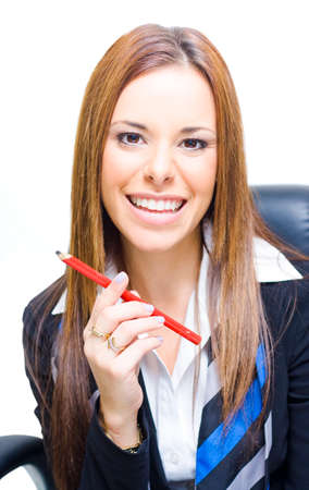 engaging: Smiling Happy Receptionist Or Secretary Sitting Holding A Red Pencil While Engaging Customers And Clients In A Great Customer Service Concept, Isolated On White Stock Photo