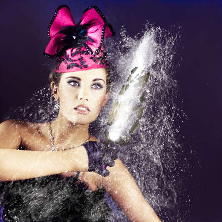 smashing: Action and excitment spray the air with a woman in fancy formal fashion holding onto a exploding bottle of champaign as water droplets splash amogst shattering debris in a image titled smashing party