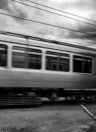dreary: A Dreary Commute With A Close Up On Two Passenger Trains Passing Each Other At Speed On An Heavily Overcast Day