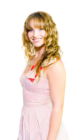 verve: Smiling extrovert woman with a pert expression and broad grin standing sideways isolated on white Stock Photo