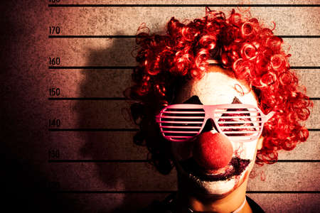 drunk: Grunge portrait of a funny clown criminal getting mug shot ID photo on police lines