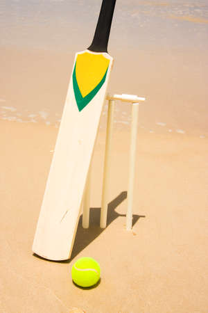positioned: Closeup Of A Beach Cricketing Set Positioned Just In Front Of The Ocean Waters Edge