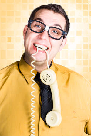 requesting: Friendly business person holding telephone in teeth when requesting feedback in a customer service satisfaction concept