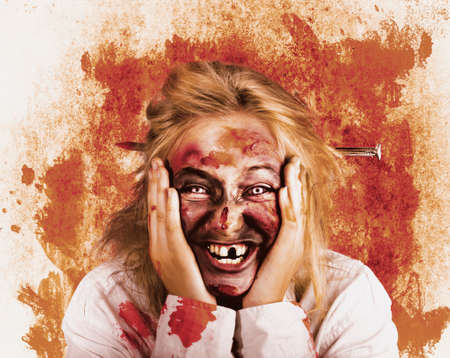 grisly: Vintage distressed portrait of a chilling female witch laughing with a wicked stare. Grunge horror concept