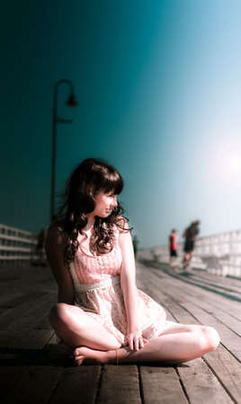recedes: Attractive Young Woman In Dress Resting And Relaxing On Wooden Walking Bridge In A Dreamy Sea Side Summer Holiday Vacation