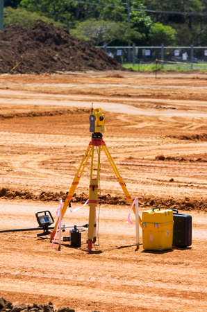 geodetic: Geodetic Analysis In Progress With A Surveyors Tachometer And Equipment On A Soon To Be Developed Construction Site Stock Photo