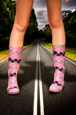 gum boots: In A Storm Rain And Weather Concept A Giant Stands In Large Gum Boots On A Road Or Highway In A Colossal Overgrown And Gigantic Image Representing The Big Wet Stock Photo