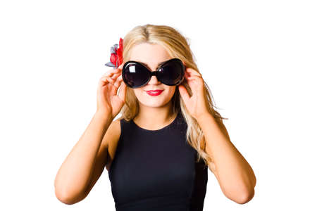 eye protection: Isolated photograph of a spray tan girl wearing eye protection goggles at tanning salon over white background. Tanning beauty