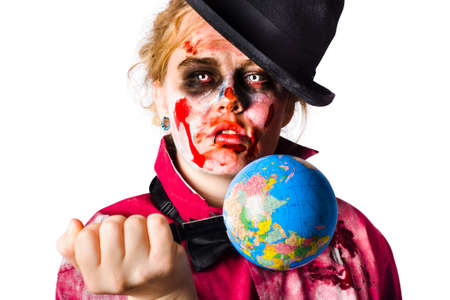 conspire: Beaten and bloody zombie woman holding a globe stabbed with a knife. Killing planet earth