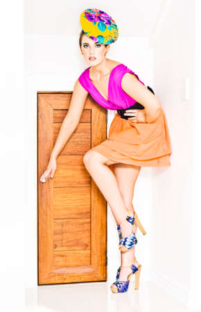 star path: Beautiful And Elegant Girl In Designer Clothing Opening A Small Doorway When Seeking A Opportunity To Break Into Fashion Stardom In A Next Top Model Conceptual Stock Photo