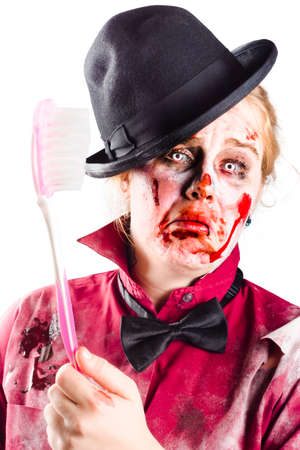 grisly: Bloody, beaten and diseased woman holding a toothbrush. Dental disease