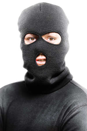 to ski: Face of a angry burglar wearing a black ski mask or balaclava isolated on white background Stock Photo