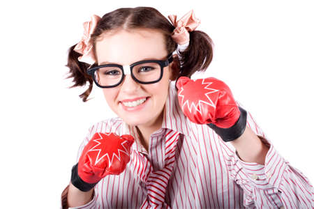 tough girl: Tough And Ambitious Business Woman Punching On In A Pair Of Boxing Gloves In A Depiction Of Hard Hitting Business Tactics
