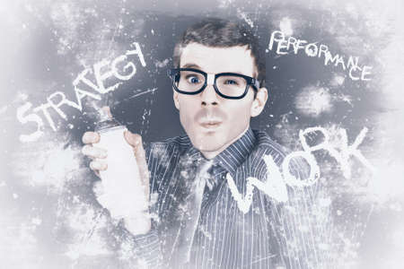 Comic portrait of a male business employee painting a strategy in performance and work with spray can. Auditing concept photo