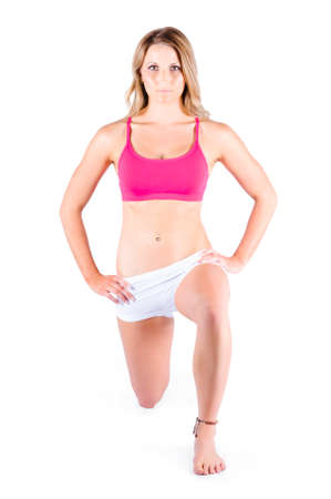 one person: Attractive young woman exercising in Pilates position, white background Stock Photo