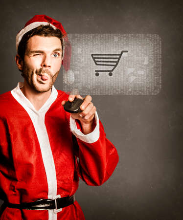 Pensive photograph of a decision making santas little helper clicking the shopping cart icon when buying online. Holiday checkout photo
