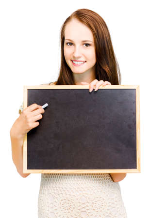 erased: Beautiful smiling natural young girl holds a blank erased chaklboard to her chest ready for your text or message