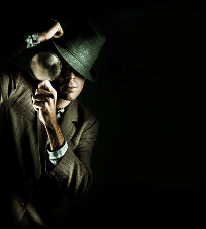 secret agent: Creative Grunge Portrait Of A Man Holding A Magnifying Glass While On A Search And Find Mission To Solve A Crime Scene Investigation, Isolated On Black