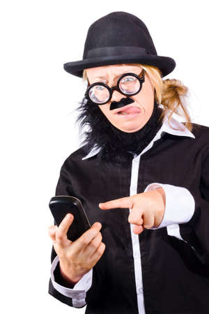 quizzical: Weird woman in black bowler hat fake beard and mustache wide rimmed glasses sending text message with phone