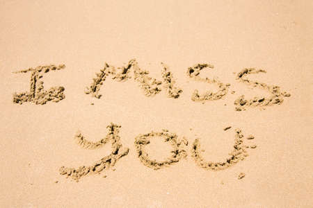 misses: Words I Miss You Hand Written In The Sand