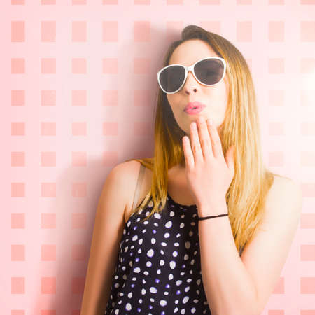 astounded: Retro makeup model with pink lips and blond hair expressing a look of emotional surprise in sunglasses. Beauty copy shop pinup girl