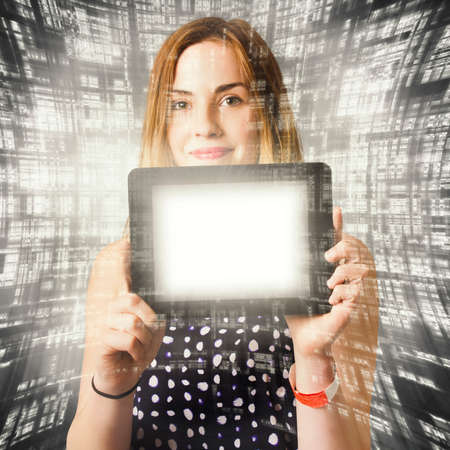 millennial: Creative technology concept on a young advertising business woman showing tech device tablet with illuminated blank copyspace screen. Millennial connectivity Stock Photo