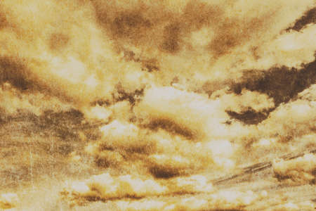 bygone days: Horizontal skyscape of atmospheric grunge clouds with scratched texture. Hostile background