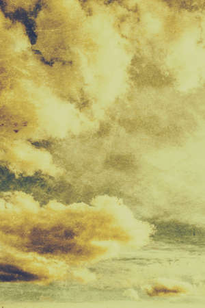 atmospheres: Old cloud texture with towering white cumulus formations in the yellow heavens above. Vintage background