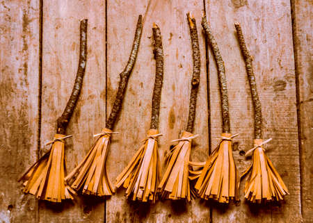spells: Gathering of spells and witchcraft with a grrouping of 6 halloween witch brooms Stock Photo