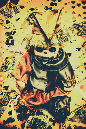 the art of divination: Possessed horror joker doll sitting upright on abstract vintage card background. Haunted dolls