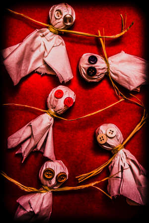 haunting: Haunting halloween ghouls and ghosts with candy monsters made from lollipops and tissues with creepy button eyes. Spooky trick or treaters