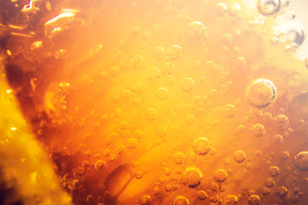 full frame: Full frame close up of orange soda water with various sized bubbles and copy space Stock Photo