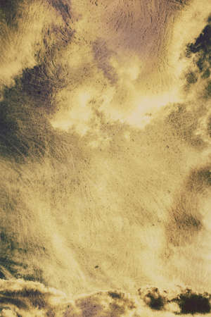 heavy effect: Sepia toned image of sky background with heavy storm clouds before a thunderstorm, vintage filter effect
