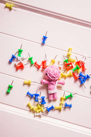contempory: Handmade mummy halloween voodoo doll with colorful pins on wooden planks