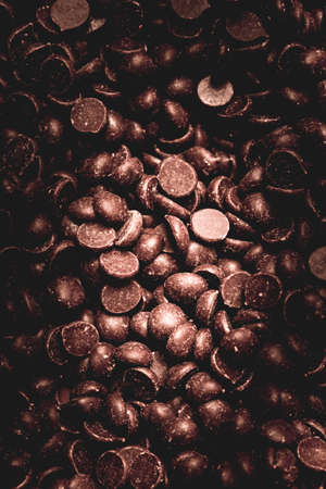 sumptuous: Full frame background of chocolate chips for concept about delicious baking sweeteners