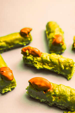 witchery: Cake pieces resembling spooky monster witches fingers toppled with pistachio and chocolate icing, halloween treats