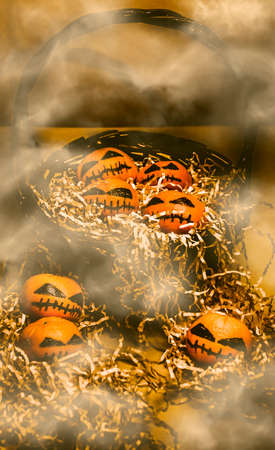 freaky: Scary dead pumpkins heads in a misty horror scene of halloween decorating madness. Mandarin freaky fruits