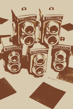 reflex: Vintage creative artwork on old twin lens camera icons over blank nostalgia instant film photos. Vintage snapshots and old cameras Stock Photo