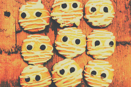 kooky: Retro toned baking batch of creepy and kooky cookie mummies with all with scary looks of halloween fear