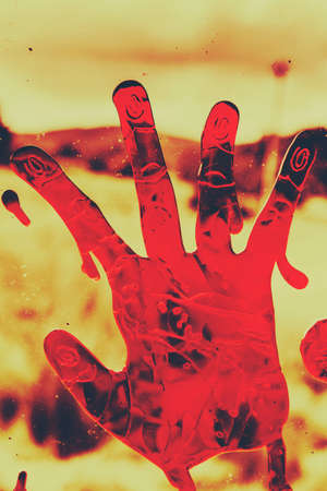 grisly: Bloody Halloween palm print left by a beseeching victim in the throes of death Stock Photo