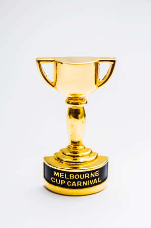 Melbourne cup horse race trophy decoration on grey background. Australian events still life