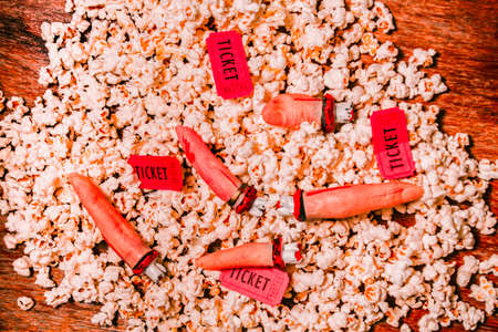 slasher: Directors cut in slasher movie snacks with dead fingers mixed with slices of theatre drama and popcorn. Horror show Stock Photo